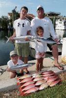 Fishing with Kids Photo Gallery: Rod Bending Fun with the Kids, and great eating too! Islamorada Fishing Charter Florida Keys